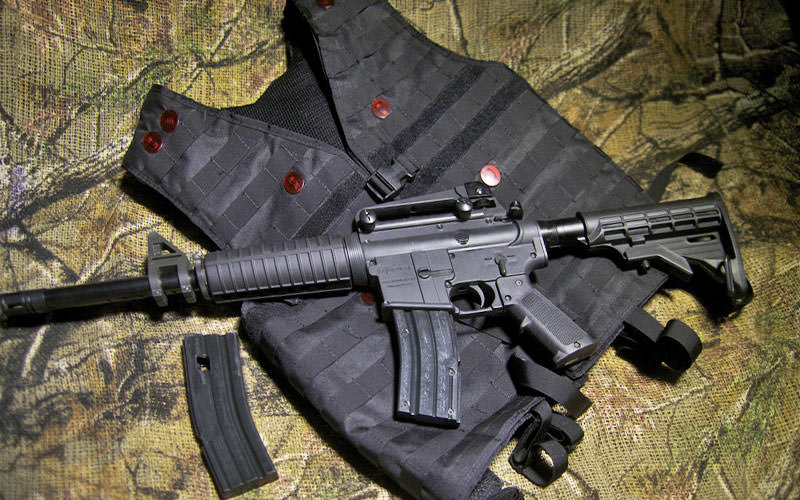 A black iCombat gun and vest