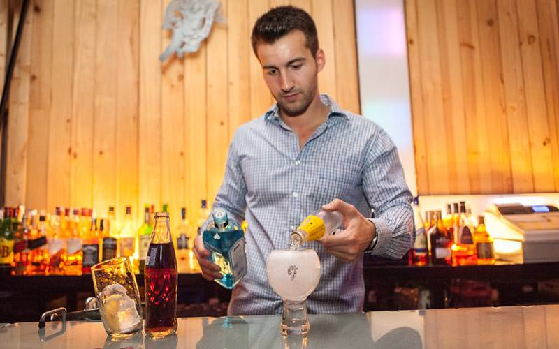 A man making a gin cocktail