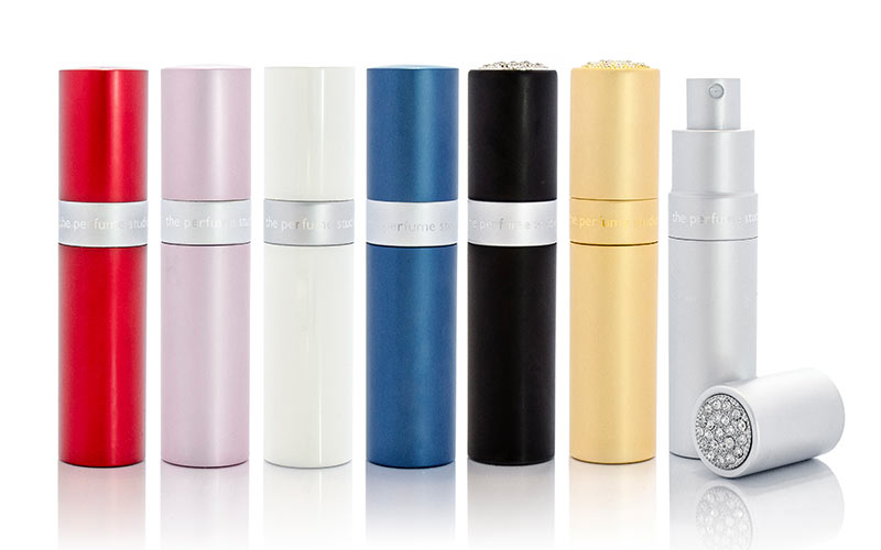 Some perfume atomisers in differently coloured bottles