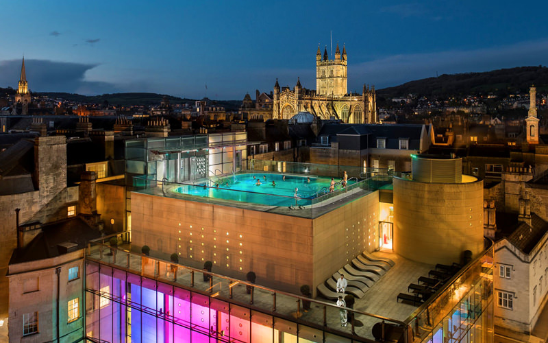 A view of a rooftop thermae spa at night