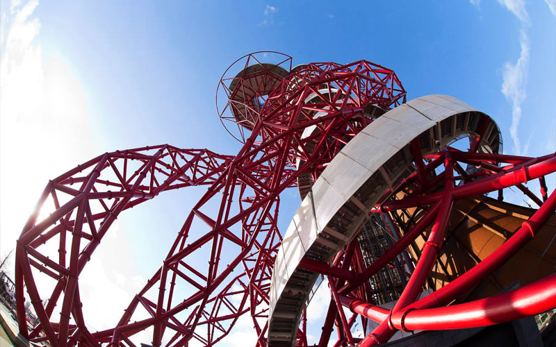 The Slide at ArcelorMittal Orbit in London from below with the blue sky providing the background