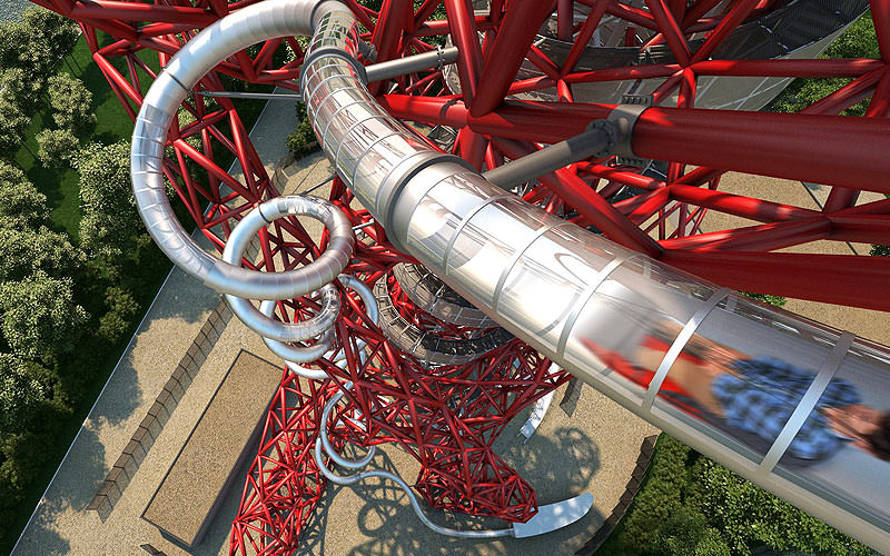 The Slide at ArcelorMittal Orbit from above with a man on a board sliding down it