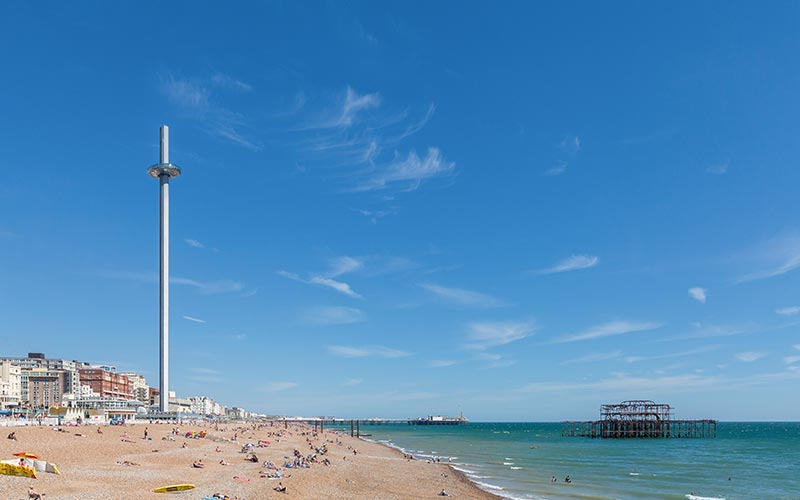 British Airways i360 towering over the beach and the sea