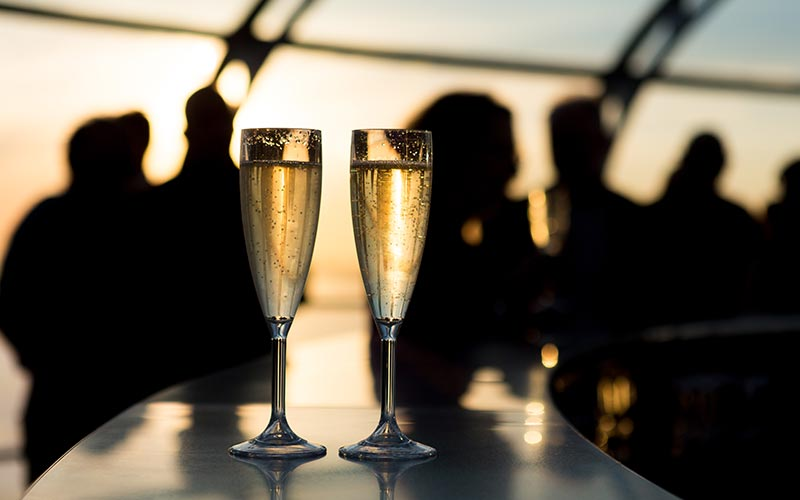 Two glasses of Champagne to a backdrop of silhouettes
