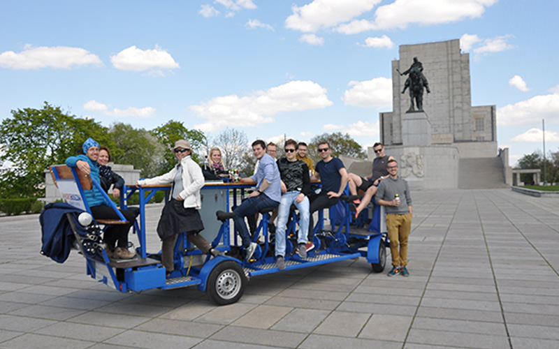 A group of men on a beer bike in Prague
