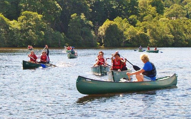 Multiple kayaks on a lake