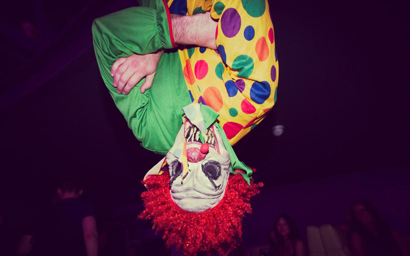 A clown hanging from the ceiling in Circo