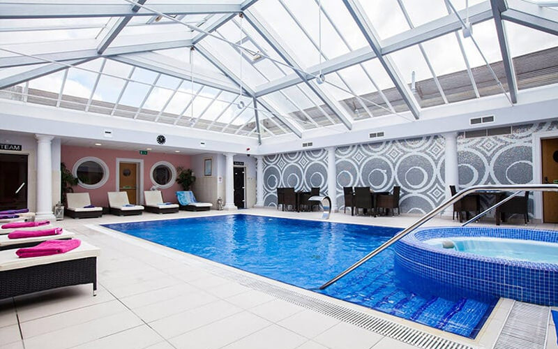 A small swimming pool with jacuzzi in a spa