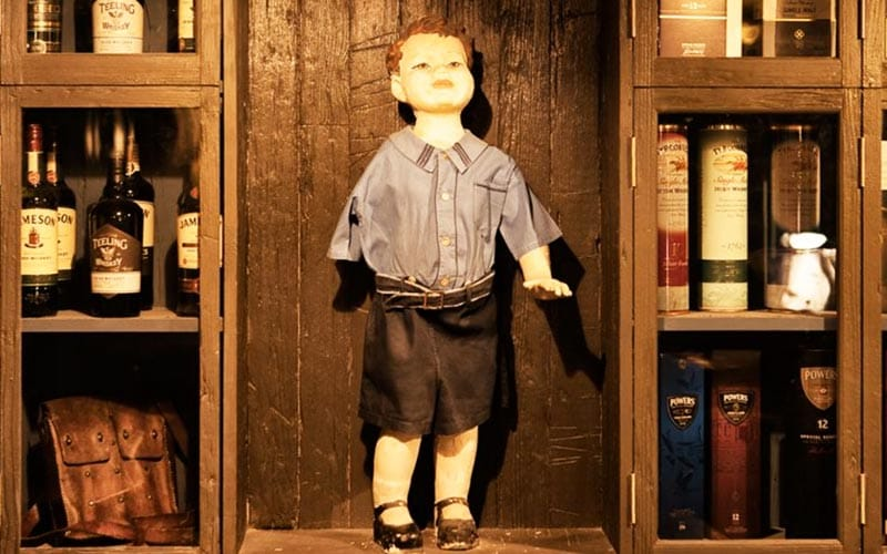 A mannequin of a little boy in The Rag Trader
