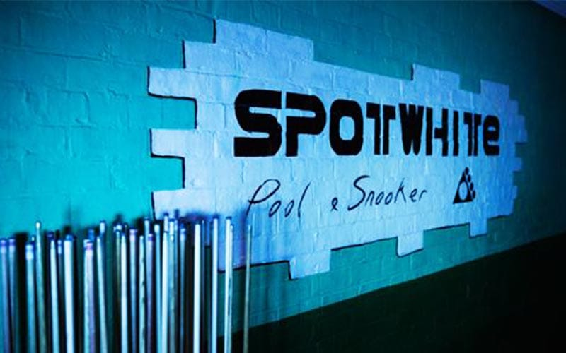 Spot White pool and snnoker logo in black on the wall.
