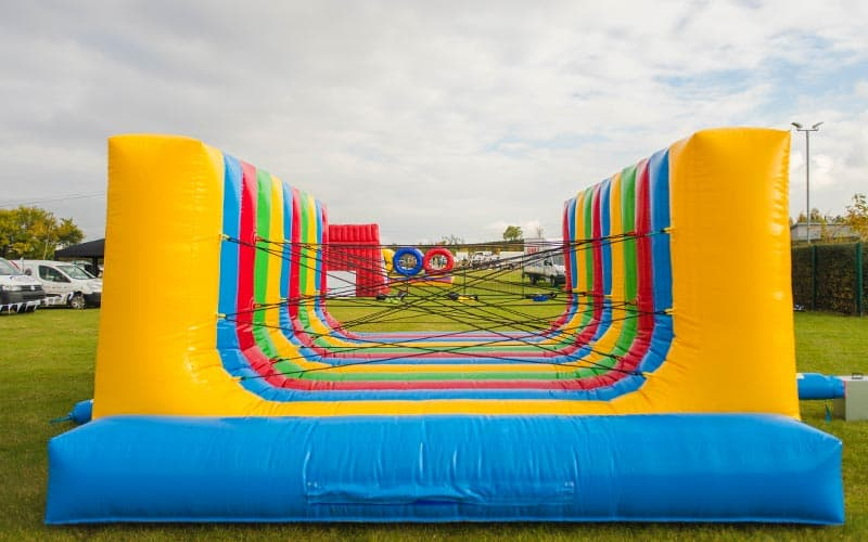 The large, inflated spider's web style bouncy castle