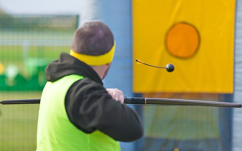 A man firing a bow and arrow at a target