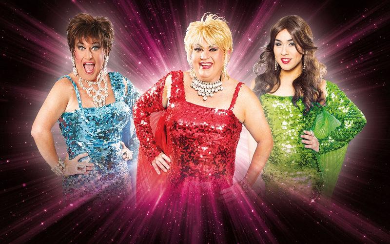 Three drag queens wearing sequin dresses