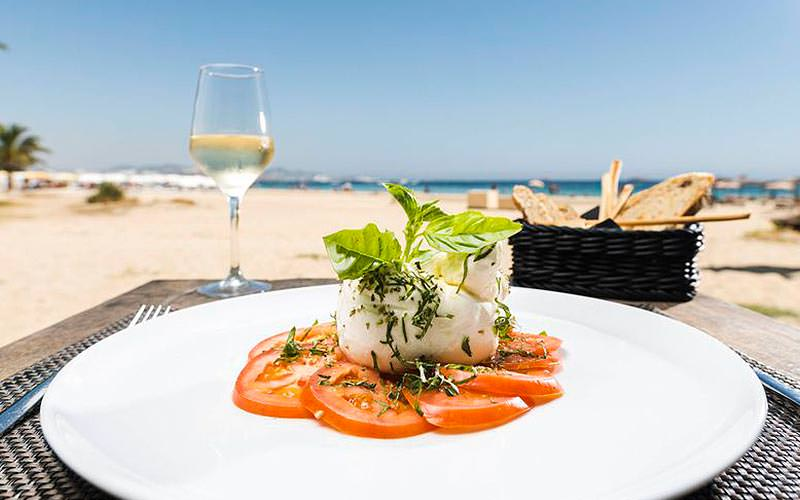 A plate of food on the beach