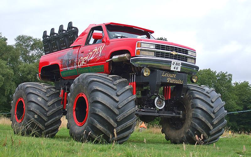 Red monster truck in a field
