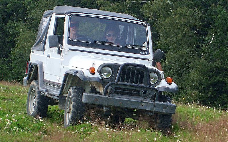 Two people blind driving in a jeep