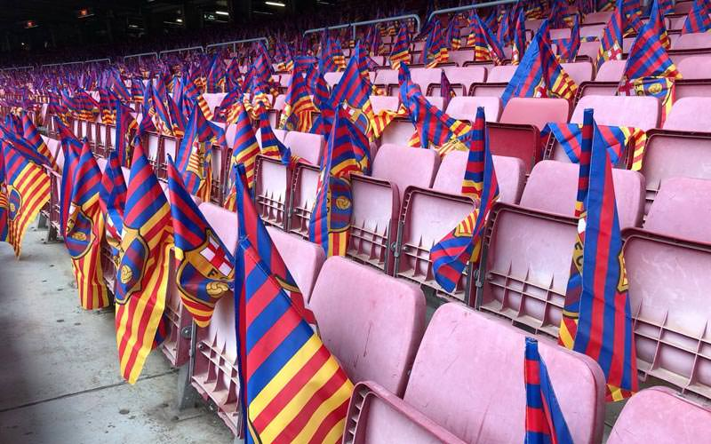 Images of the seats inside the football stadium and each seat with a barcelona flag