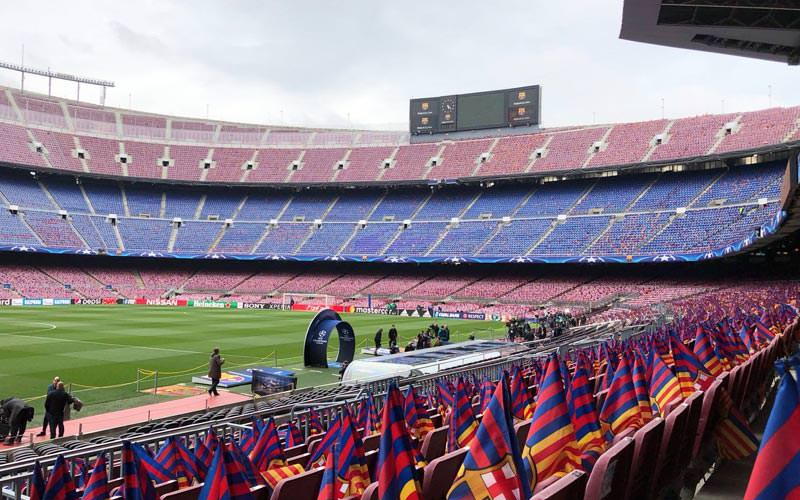 Image of a view from standing at one of the turnstiles inside the barcelona camp nou stadium