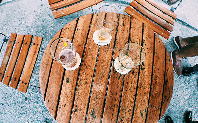 Empty glasses on a wooden table