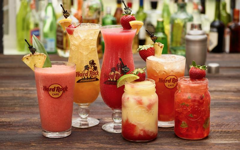 Image of a selection of cocktails in different shaped glasses all labelled with the hard rock cafe logo