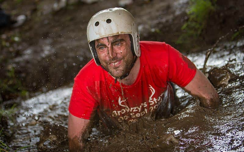 A man crawling through mud