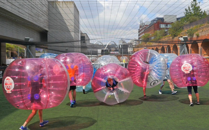A group of men playing bubble football