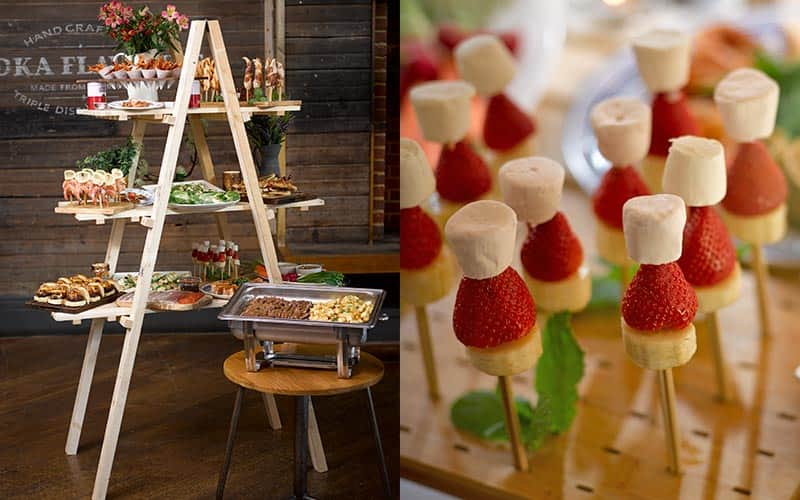 Split image of food served on a makeshift ladder, and skewers of banana, strawberry and marshmallow in a wooden board