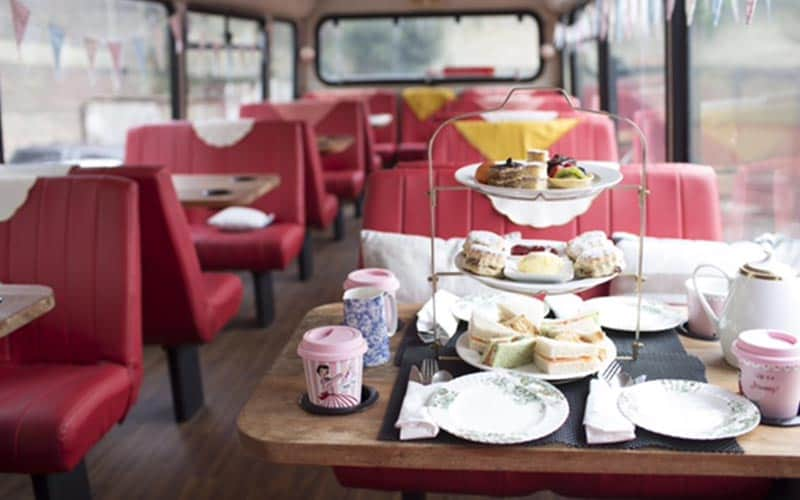 An three tier afternoon tea on a table on a bus