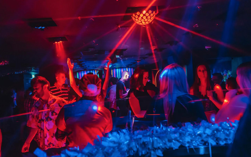 A group of people in a club dancing