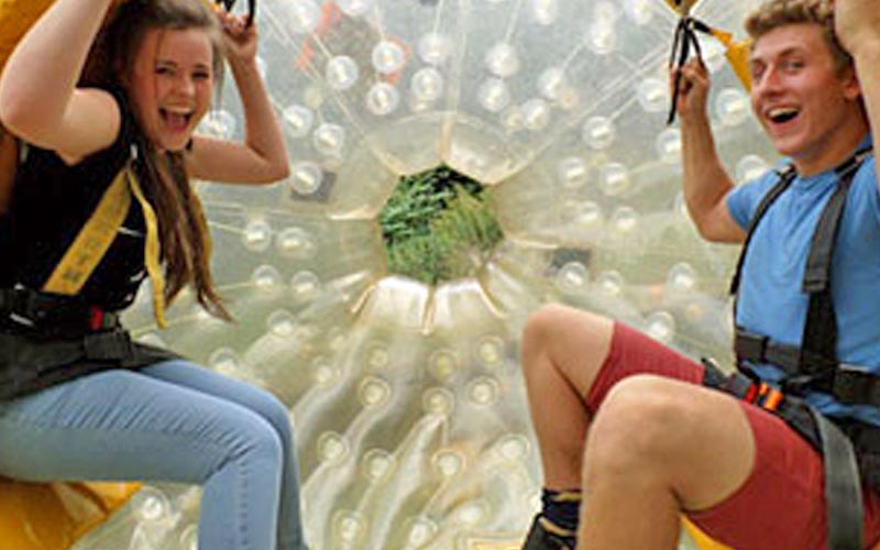 Two people sat inside a zorb