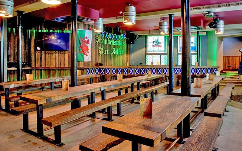 The long wooden benches inside Frankenstein Bierkeller