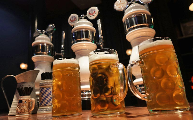 Three steins on the bar in Frankenstein Bierkeller