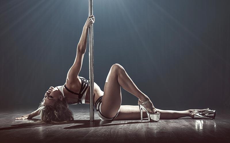 A woman posing on a pole
