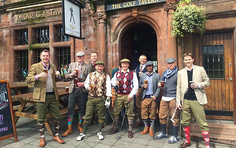 A group of men dressed in golfing attire, stood outside The Golf Tavern, Edinburgh