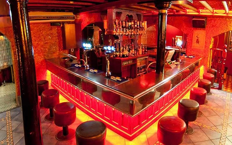 A red lit up bar at Espionage, Edinburgh