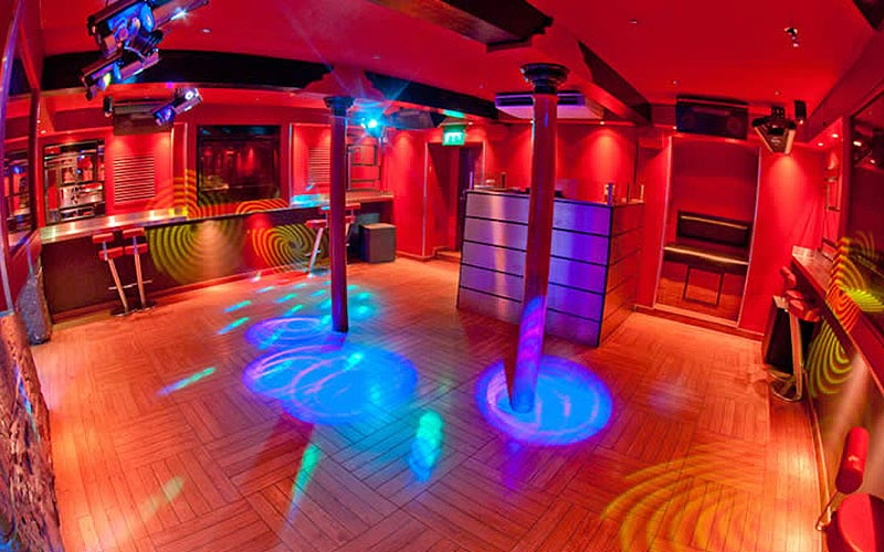 An empty dance floor at Espionage, Edinburgh, to a backdrop of red light