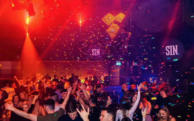 A large crowd dancing in a nightclub