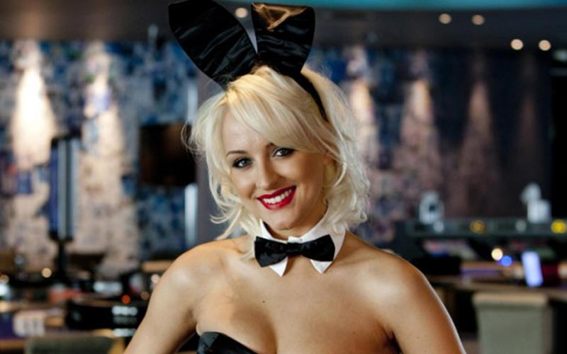 A blonde girl wearing a black bow tie and bunny ears