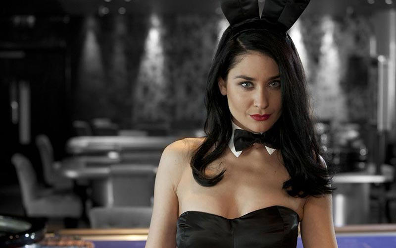 A black haired girl wearing a black bow tie and bunny ears
