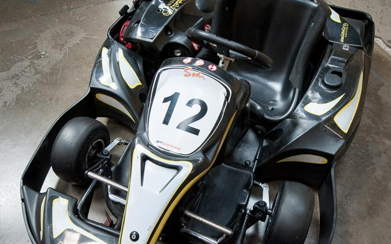A go kart with number 12 on the front