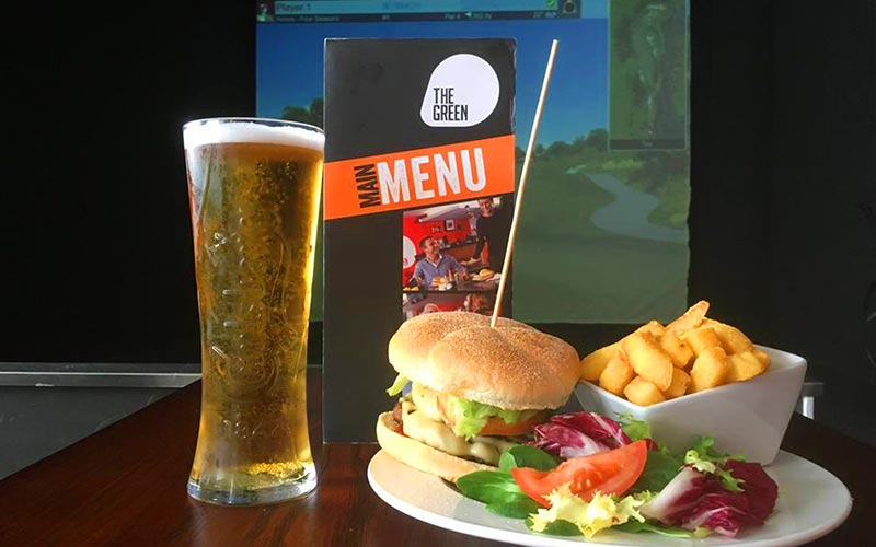 A burger and chips meal with a pint to the side