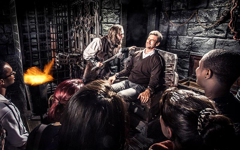 A visitor interacting with actors in the York Dungeon