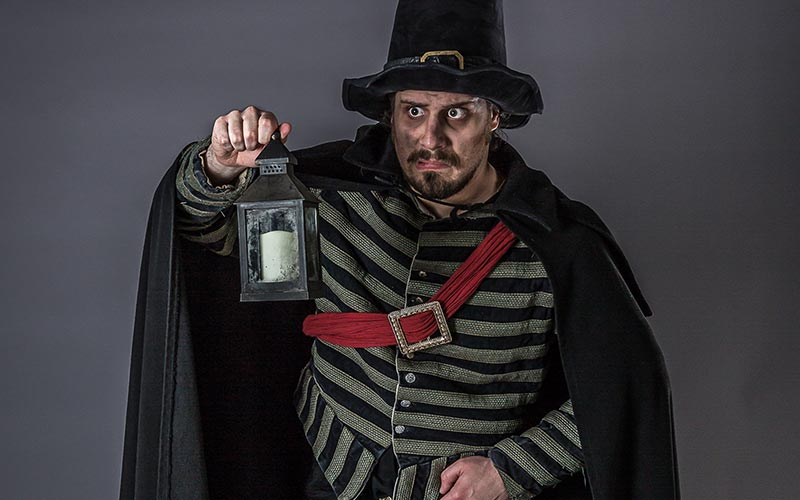 An actor dressed as someone from medieval York in the York Dungeon