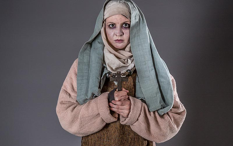 A woman dressed up as a plague victim
