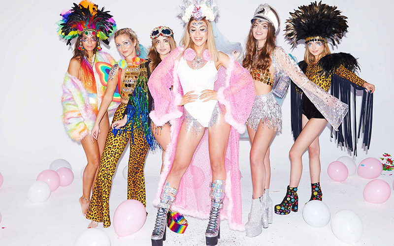 Six girls dressed in fun, festival outfits