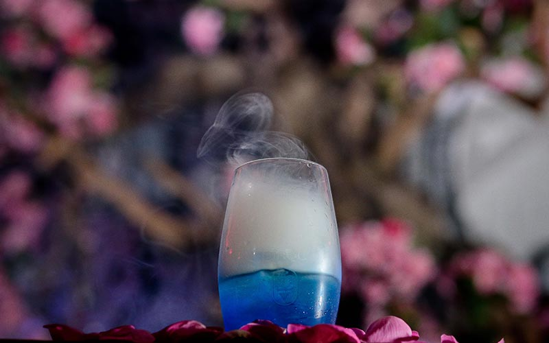 A blue smoking cocktail