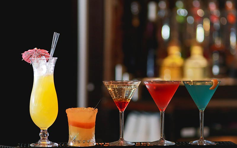 Some cocktails lined up on a bar in Tup Tup