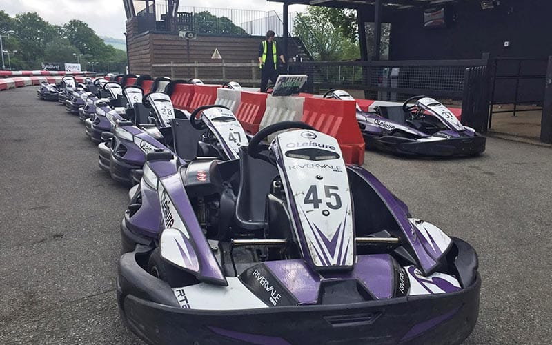 Lots of go karts lined up outside
