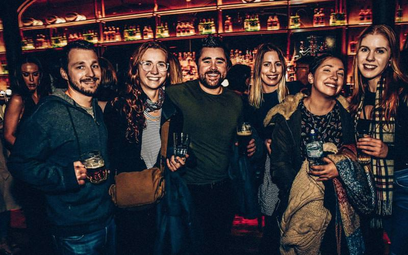 Image of a group of people inside a bar in belfast on a bar crawl
