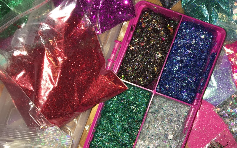 Some of the glitter jams laid out on a table